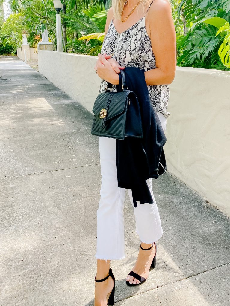 White Jeans + Python top +Black BagWhite Jeans For Date Night! 5 outfit ideas for women over 50.